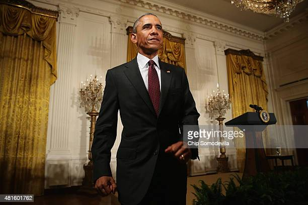 S President Barack Obama moves to greet guests after delivering remarks at a reception celebrating the reauthorization of the African Growth and...