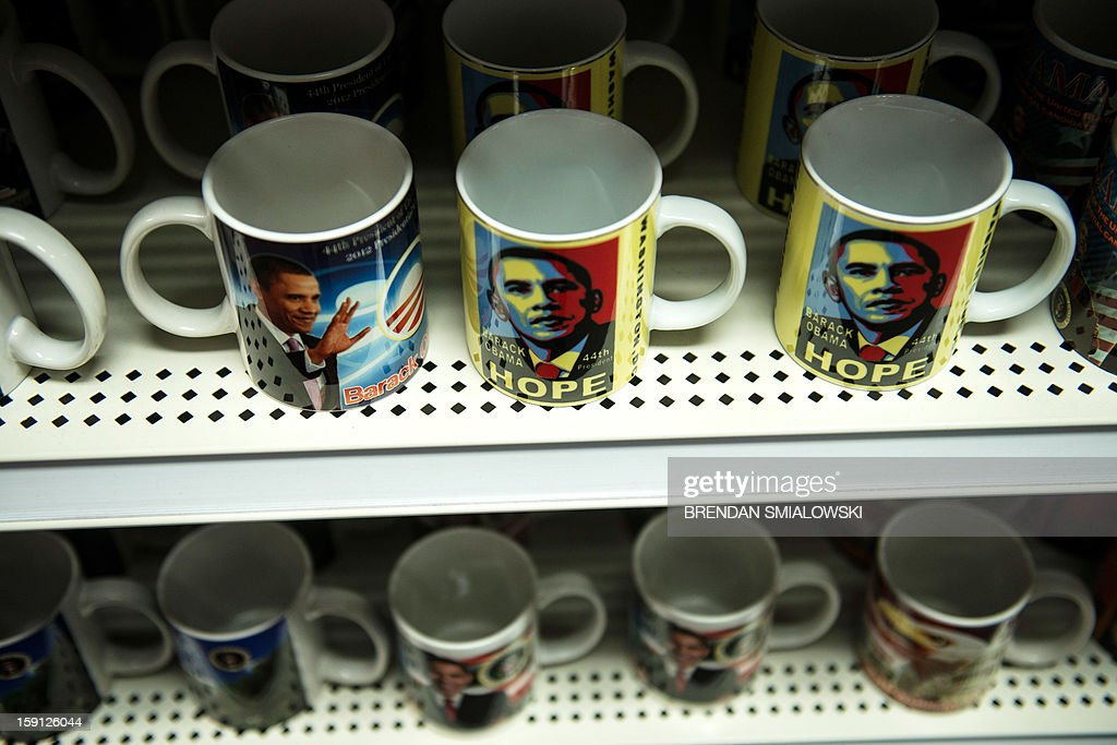 US President Barack Obama mugs are seen at the Souvenir World shop in Washington on January 8, 2013. Preparations continue for Obama's inauguration for his second term on January 21. AFP PHOTO/Brendan SMIALOWSKI
