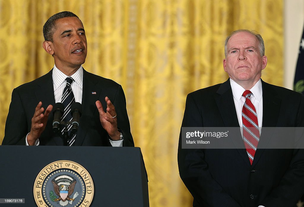 U.S. President Barack Obama (L) nominates chief counterterrorism adviser John Brennan (R), to be CIA Director during an event in the East Room at the White House on January 7, 2013 in Washington, DC. Pending approval by the Senate, chief counterterrorism adviser John Brennan will be the next director of the Central Intelligence Agency following the resignation of Army Gen. David Petraeus.