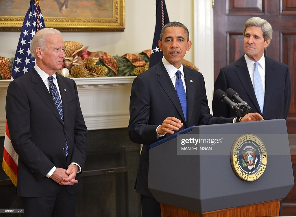 US President Barack Obama nominates US Senator John Kerry (R) as his choice for the next secretary of state as Vice President Joe Biden (L) watches on December 21, 2012 in the Roosevelt Room of the White House in Washington, DC. AFP PHOTO/Mandel NGAN