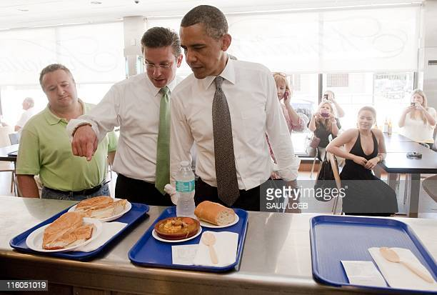 US President Barack Obama orders lunch alongside Alejandro Garcia Padilla a Puerto Rican Senator and President of the Popular Democratic Party of...