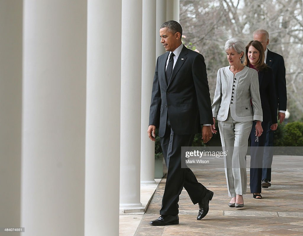 , U.S. President Barack Obama (L), outgoing Health and Human Services Secretary Kathleen Sebelius, Director of the White House Office of Management and Budget Sylvia Mathews Burwell, and U.S. Vice President Joe Biden walk to an event in the Rose Garden at the White House, on April 11, 2014 in Washington, DC. President Obama announced that Burwell will replace Sebelius as Secretary.