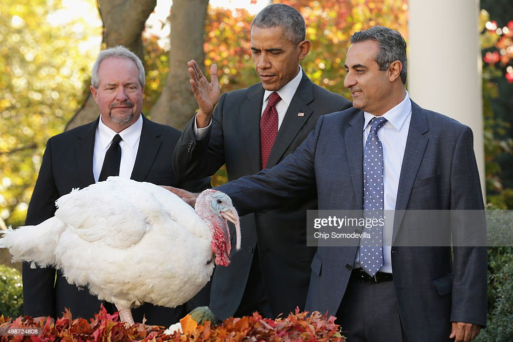 U.S. President Barack Obama (C) 'pardons' Abe, a 42-pound male turkey during a ceremony with National Turkey Federation Chairman Jihad Douglas (R) and turkey farmer Joe Hedden in the Rose Garden at the White House November 25, 2015 in Washington, DC. In a tradition dating back to 1947, the president pardons a turkey, sparing the tom -- and his alternate -- from becoming a Thanksgiving Day feast. This year, Americans were asked to choose which of two turkeys would be pardoned and to cast their votes on Twitter.