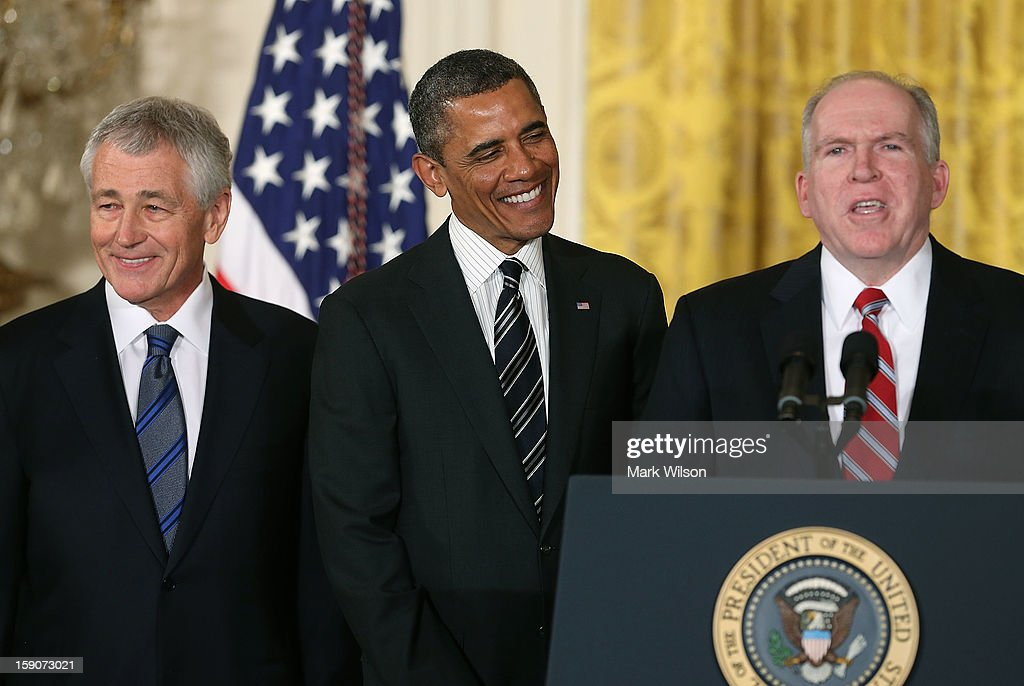 U.S. President <a gi-track='captionPersonalityLinkClicked' href=/galleries/search?phrase=Barack+Obama&family=editorial&specificpeople=203260 ng-click='$event.stopPropagation()'>Barack Obama</a> (C) participates in a news conference with chief counterterrorism adviser John Brennan (R), and former U.S. Sen. <a gi-track='captionPersonalityLinkClicked' href=/galleries/search?phrase=Chuck+Hagel&family=editorial&specificpeople=504963 ng-click='$event.stopPropagation()'>Chuck Hagel</a> (R-NE) (L) in the East Room at the White House on January 7, 2013 in Washington, DC. Pending approval by the Senate, the nomination of former U.S. Sen. <a gi-track='captionPersonalityLinkClicked' href=/galleries/search?phrase=Chuck+Hagel&family=editorial&specificpeople=504963 ng-click='$event.stopPropagation()'>Chuck Hagel</a> (R-NE) as Secretary of Defense will replace Leon Panetta and chief counterterrorism adviser John Brennan will be the next director of the Central Intelligence Agency following the resignation of Army Gen. David Petraeus.