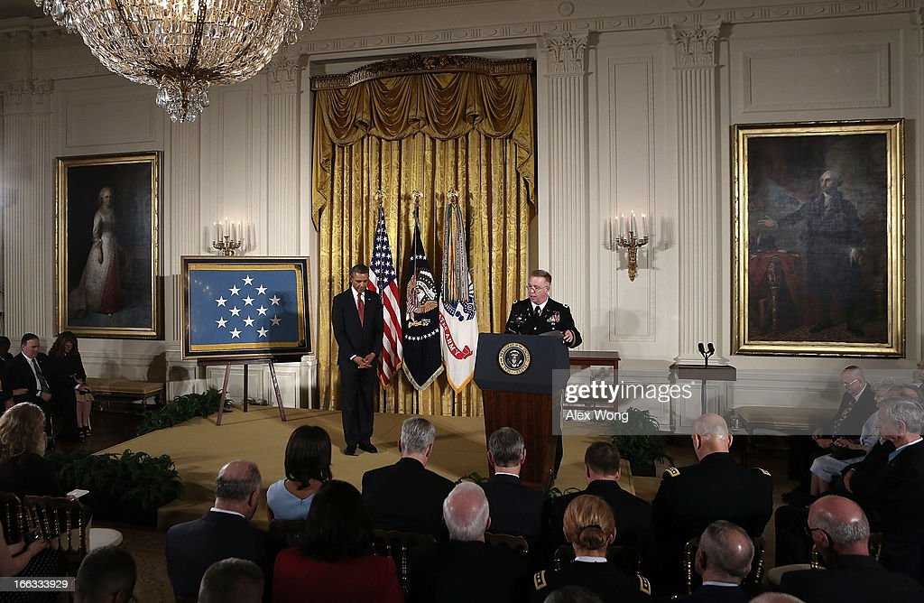 U.S. President <a gi-track='captionPersonalityLinkClicked' href=/galleries/search?phrase=Barack+Obama&family=editorial&specificpeople=203260 ng-click='$event.stopPropagation()'>Barack Obama</a> (L) participates in a prayer during a Medal of Honor Ceremony April 11, 2013 at the East Room of the White House in Washington, DC. U.S. Army Chaplain (Captain) Emil J. Kapaun received the Medal of Honor for conspicuous gallantry posthumously for his extraordinary heroism while serving with the 3d Battalion, 8th Cavalry Regiment, 1st Cavalry Division during combat operations against an armed enemy at Unsan, Korea and as a prisoner of war from November 1-2, 1950.
