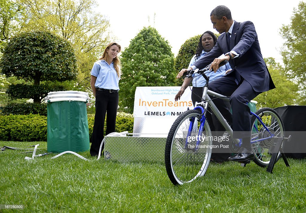 President Barack Obama participates in a science experiment with Northeast High School students Payton Kaar, 18, and Kiona Elliott, 18 of Oakland, Florida at the White House in Washington, D.C. on April 22, 2013. InvenTeams Teens design pedal-powered filtration system: High-schoolers Payton Karr and Kiona Elliot, from Oakland Park, Florida, led a team of inventors who designed a collapsible, transportable, bicycle-powered emergency water-sanitation station that filters E. coli and other harmful pathogens from contaminated water. In emergencies, the device can be assembled and disassembled in under an hour, and can produce enough water to hydrate 20 – 30 people during a 15 hour period. Payton, Kiona, and their Northeast High School classmates received a 2012 InvenTeam grant from the Lemelson-MIT Program, which supported their development of the innovative design. Both Payton and Kiona intend to be the first in their families to attend college. President Barack Obama hosts the White House Science Fair to celebrate the student winners of a broad range of science, technology, engineering and math (STEM) competitions from across the country.