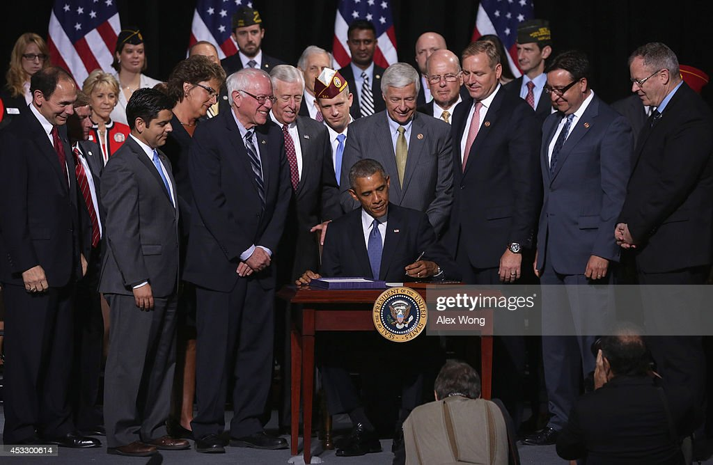 U.S. President <a gi-track='captionPersonalityLinkClicked' href=/galleries/search?phrase=Barack+Obama&family=editorial&specificpeople=203260 ng-click='$event.stopPropagation()'>Barack Obama</a> participates in a signing ceremony for H.R. 3230 as (L-R) Secretary of Veterans Affairs Robert McDonald, Rep. Raul Ruiz (D-CA), Rep. Jackie Walorski (R-IN), Sen. <a gi-track='captionPersonalityLinkClicked' href=/galleries/search?phrase=Bernie+Sanders&family=editorial&specificpeople=2908340 ng-click='$event.stopPropagation()'>Bernie Sanders</a> (I-VT), House Minority Whip Rep. <a gi-track='captionPersonalityLinkClicked' href=/galleries/search?phrase=Steny+Hoyer&family=editorial&specificpeople=588093 ng-click='$event.stopPropagation()'>Steny Hoyer</a> (D-MD), Rep. Michael Michaud (D-ME), Rep. Jeff Denham (R-CA), Rep. Pete Gallego (D-TX) and Rep. Morgan Griffith (R-VA) look on August 7, 2014 at Wallace Theater in Fort Belvoir, Virginia. President Obama has signed the Veterans' Access to Care through Choice, Accountability, and Transparency Act of 2014 into law.