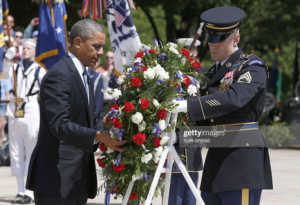 US President Barack Obama participates in a wreath laying ceremony at the Tomb of the Unknown Soldier in honor of Memorial Day at Arlington National...