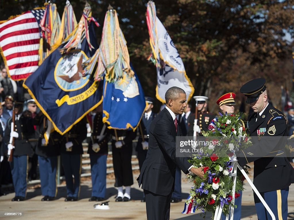 US President Barack Obama participates in a wreath laying ceremony at the Tomb of the Unknown Soldier in honor of Veteran's Day at Arlington National...