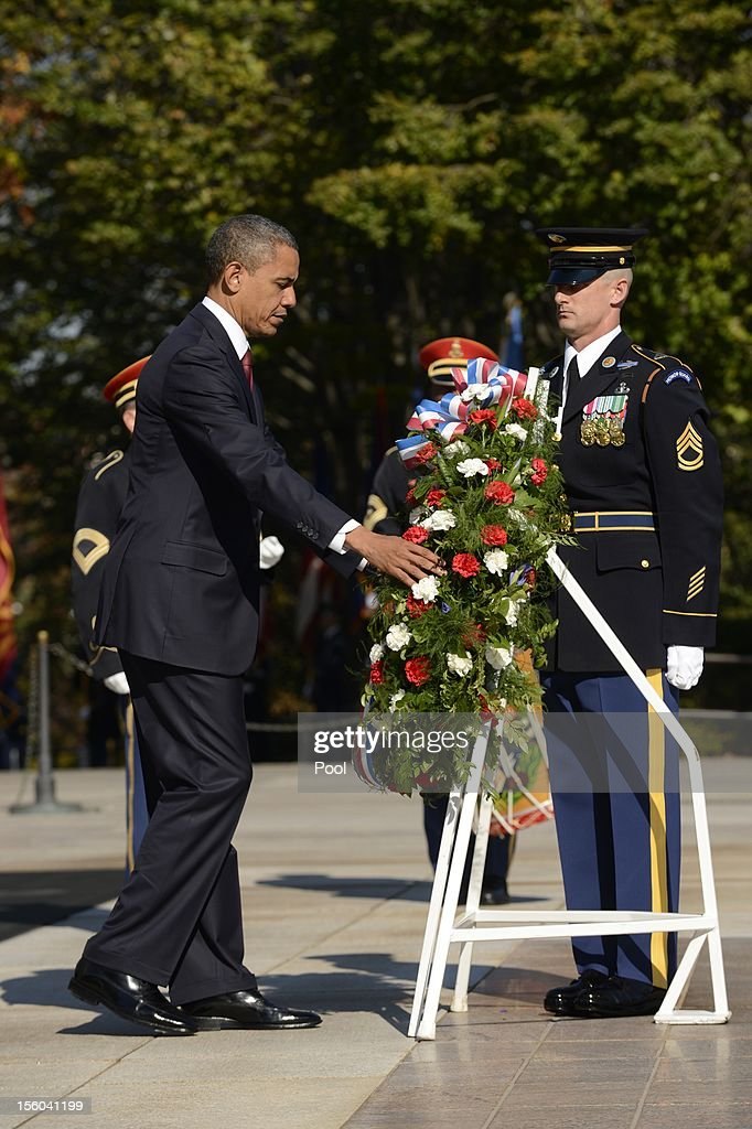 U.S. President Barack Obama participates in a wreath-laying ceremony on Veteran's Day at the Tomb of the Unknown Soldier in Arlington National Cemetery on November 11, 2012 in Arlington, Virginia.