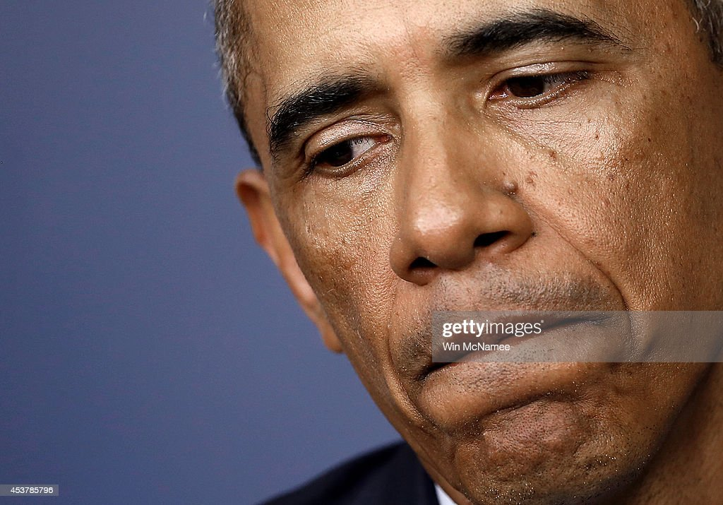 U.S. President <a gi-track='captionPersonalityLinkClicked' href=/galleries/search?phrase=Barack+Obama&family=editorial&specificpeople=203260 ng-click='$event.stopPropagation()'>Barack Obama</a> pauses as he answers a question about the situation in Ferguson, Missouri during a press conference in the Brady Press Briefing Room of the White House on August 18, 2014 in Washington, DC. Obama returned early from his vacation in Martha's Vineyard to hold meetings with his national security team and also with U.S. Attorney General Eric Holder in regards to the situation in Iraq and the continuing violence in Ferguson, Missouri.