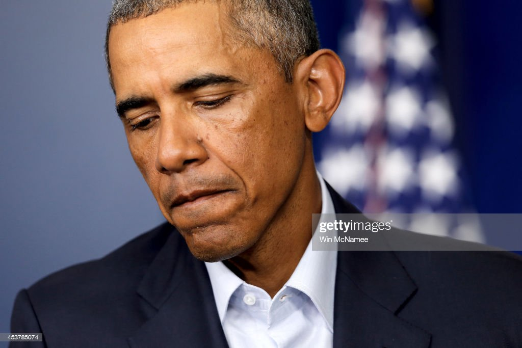 U.S. President <a gi-track='captionPersonalityLinkClicked' href=/galleries/search?phrase=Barack+Obama&family=editorial&specificpeople=203260 ng-click='$event.stopPropagation()'>Barack Obama</a> pauses as he gives a statement during a press conference in the Brady Press Briefing Room of the White House on August 18, 2014 in Washington, DC. Obama returned early from his vacation in Martha's Vineyard to hold meetings with his national security team and also with U.S. Attorney General Eric Holder in regards to the situation in Iraq and the continuing violence in Ferguson, Missouri.