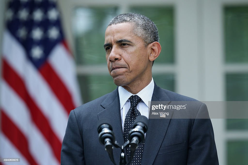 U.S. President <a gi-track='captionPersonalityLinkClicked' href=/galleries/search?phrase=Barack+Obama&family=editorial&specificpeople=203260 ng-click='$event.stopPropagation()'>Barack Obama</a> pauses as he makes a statement about military troop pullout from Afghanistan at the Rose Garden of the White House on May 27, 2014 in Washington, DC. The administration's plan is to keep a contingency force of 9,800 U.S. troops in Afghanistan beyond 2014, consolidating them in Kabul and on Bagram Air Base.
