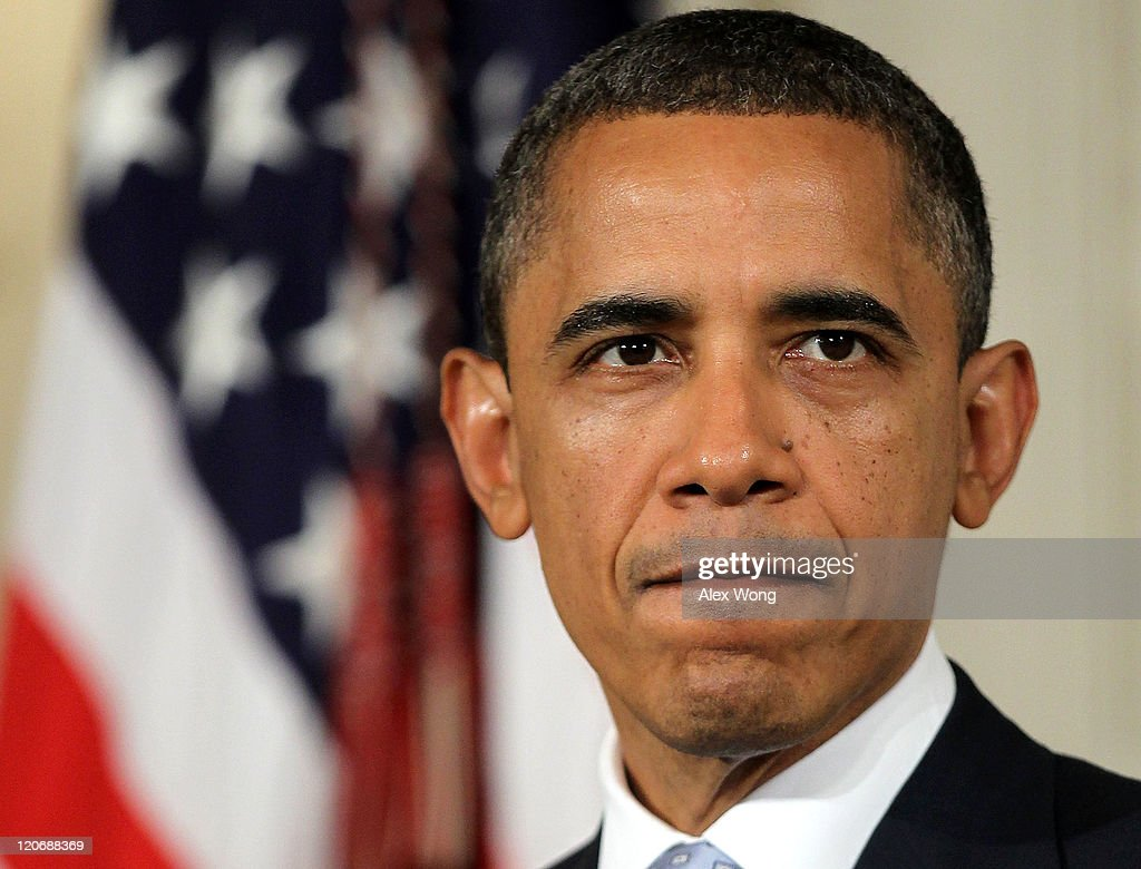 U.S. President <a gi-track='captionPersonalityLinkClicked' href=/galleries/search?phrase=Barack+Obama&family=editorial&specificpeople=203260 ng-click='$event.stopPropagation()'>Barack Obama</a> pauses as he makes a statement at the State Dining Room of the White House August 8, 2011 in Washington, DC. Obama spoke on the economy, S&P downgrade and the loss of Navy SEAL members in Afghanistan.