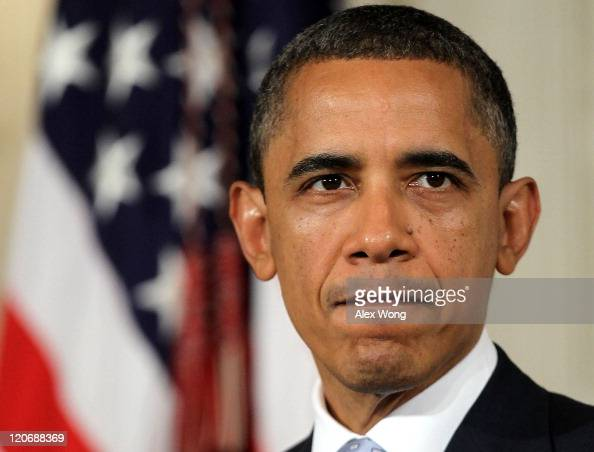 S President Barack Obama pauses as he makes a statement at the State Dining Room of the White House August 8 2011 in Washington DC Obama spoke on the...