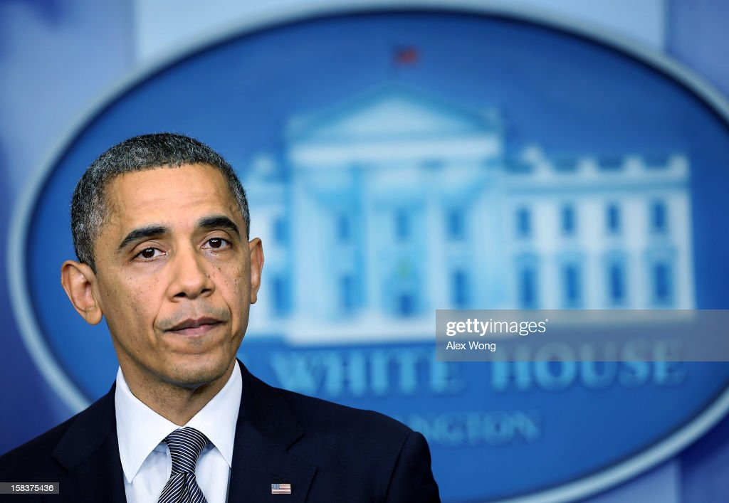 U.S. President <a gi-track='captionPersonalityLinkClicked' href=/galleries/search?phrase=Barack+Obama&family=editorial&specificpeople=203260 ng-click='$event.stopPropagation()'>Barack Obama</a> pauses as he makes a statement in response to the elementary school shooting in Connecticut ut December 14, 2012 at the White House in Washington, DC. There are 27 dead, 20 of them children, after Adam Lanza reportedly opened fire in one of the largest school massacres in U.S. history. Lanza is dead at the scene and his mother, a teacher at the school, is also dead.
