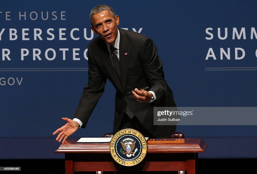 U.S. President Barack Obama pauses as he signs an executive order during the White House Summit on Cybersecurity and Consumer Protection on February 13, 2015 in Stanford, California. President Obama joined corporate CEOs to speak about the imporatance of cybersecurity during the White House Summit on Cybersecurity and Consumer Protection.