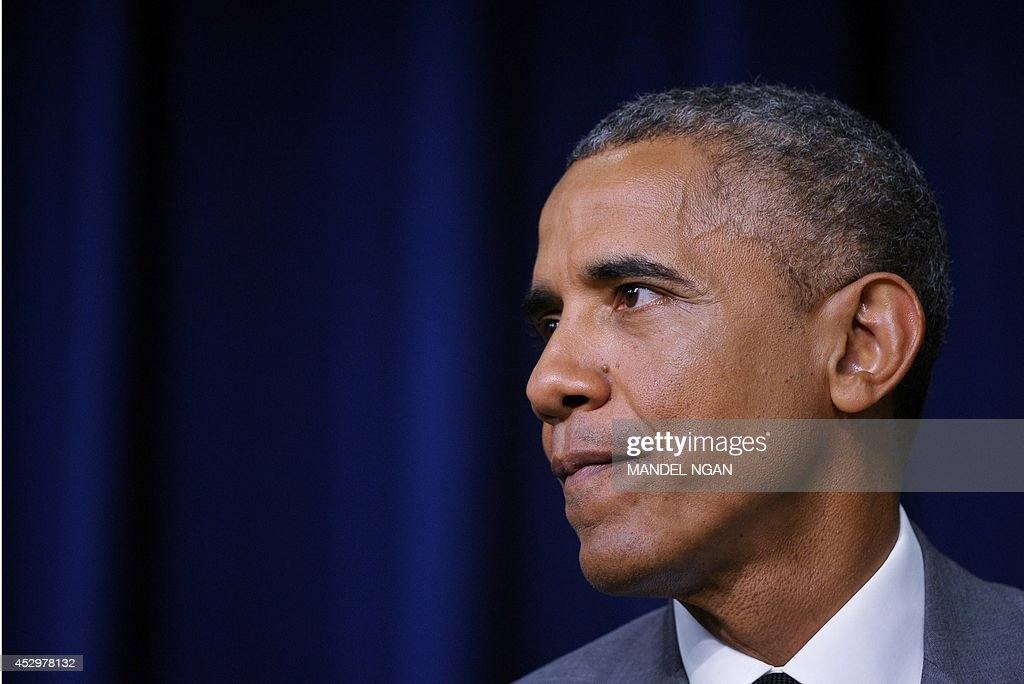 US President <a gi-track='captionPersonalityLinkClicked' href=/galleries/search?phrase=Barack+Obama&family=editorial&specificpeople=203260 ng-click='$event.stopPropagation()'>Barack Obama</a> pauses as he speaks before signing the Fair Pay and Safe Workplace executive order on July 31, 2014 in the South Court Auditorium of the Eisenhower Executive Office Building, next to the White House in Washington, DC. AFP PHOTO/Mandel NGAN