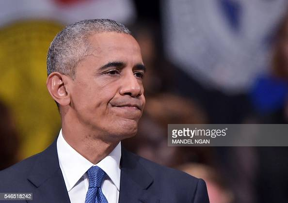 US President Barack Obama pauses as he speaks during an interfaith memorial service for the victims of the Dallas police shooting at the Morton H...