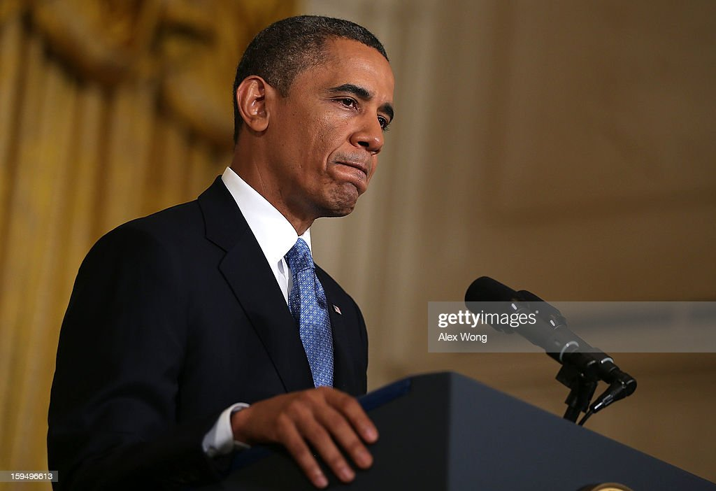 U.S. President <a gi-track='captionPersonalityLinkClicked' href=/galleries/search?phrase=Barack+Obama&family=editorial&specificpeople=203260 ng-click='$event.stopPropagation()'>Barack Obama</a> pauses as he speaks during his final news conference of his first term in the East Room of the White House January 14, 2013 in Washington, DC. Obama spoke on the debt ceiling and deficit reduction during the news conference.