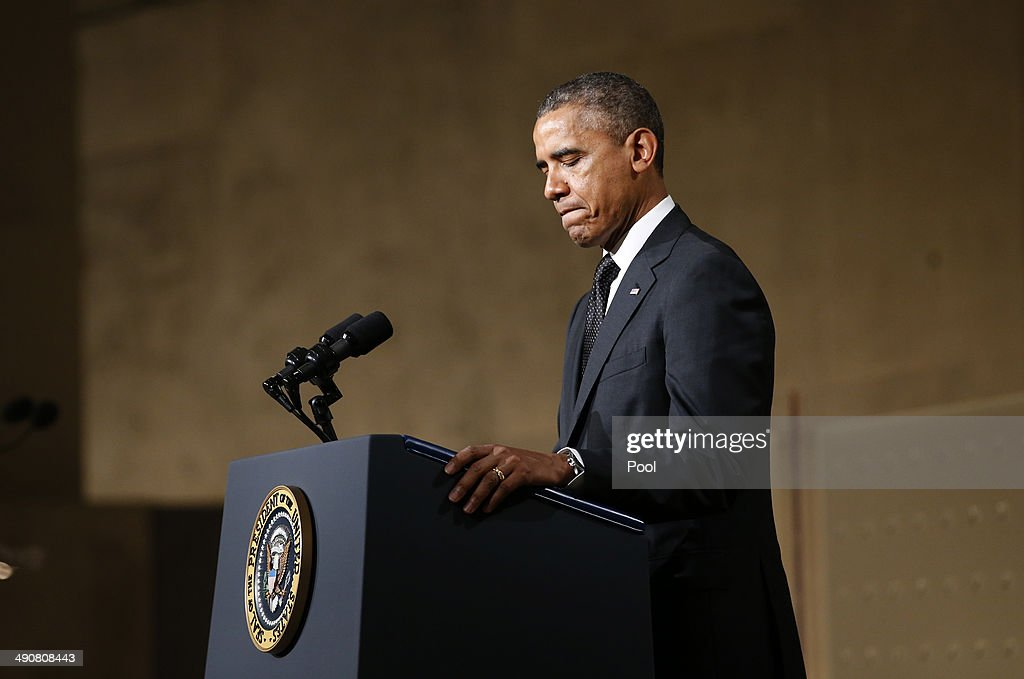 U.S. President <a gi-track='captionPersonalityLinkClicked' href=/galleries/search?phrase=Barack+Obama&family=editorial&specificpeople=203260 ng-click='$event.stopPropagation()'>Barack Obama</a> pauses as he speaks during the opening ceremony for the National September 11 Memorial Museum at ground zero May 15, 2014 in New York City. The museum spans seven stories, mostly underground, and contains artifacts from the attack on the World Trade Center Towers on September 11, 2001 that include the 80 ft high tridents, the so-called 'Ground Zero Cross,' the destroyed remains of Company 21's New York Fire Department Engine as well as smaller items such as letter that fell from a hijacked plane and posters of missing loved ones projected onto the wall of the museum. The museum will open to the public on May 21.