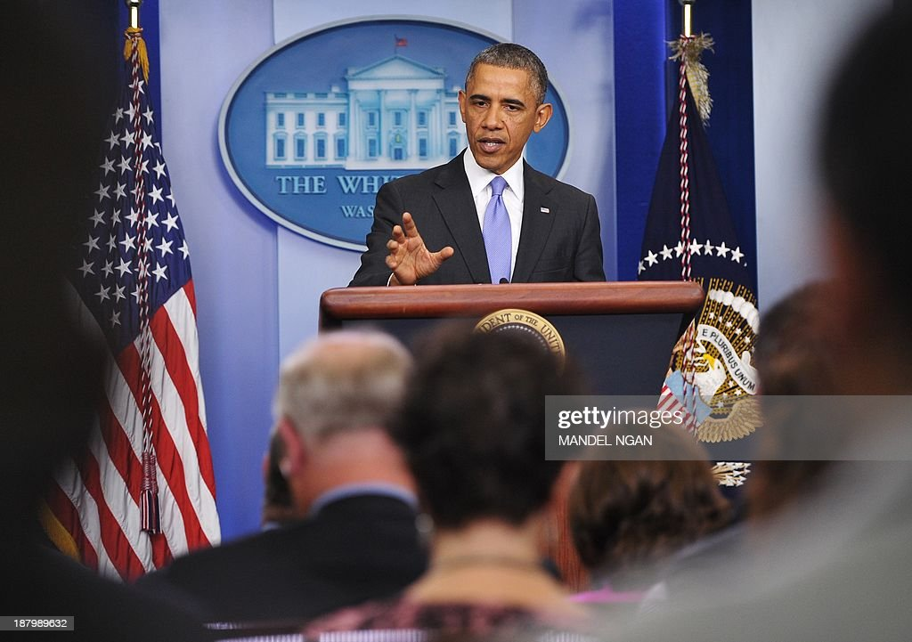 US President Barack Obama pauses as he speaks on the Affordable Care Act in the Brady Press Briefing Room of the White House on November 14, 2013 in Washington, DC. Obama said Thursday that Americans should be allowed to keep canceled health plans for an extra year as he acknowledged a 'rough' start to reforms. Obama, however, vowed to push ahead with his overall push to expand US health care coverage, vowing to block bids to return to a 'broken' system that left millions uninsured. AFP PHOTO/Mandel NGAN