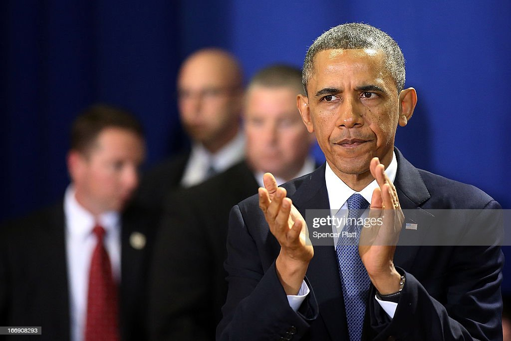President <a gi-track='captionPersonalityLinkClicked' href=/galleries/search?phrase=Barack+Obama&family=editorial&specificpeople=203260 ng-click='$event.stopPropagation()'>Barack Obama</a> pauses before speaking to runners and Boston Marathon volunteers at Cathedral High School after attending an interfaith prayer service for victims of the Boston Marathon attack titled 'Healing Our City,' at the Cathedral of the Holy Cross on April 18, 2013 in Boston, Massachusetts. Authorities investigating the attack on the Boston Marathon have shifted their focus to locating the person who placed a black bag down and walked away just before the bombs went off. The twin bombings at the 116-year-old Boston race, which occurred near the marathon finish line, resulted in the deaths of three people and more than 170 others injured.