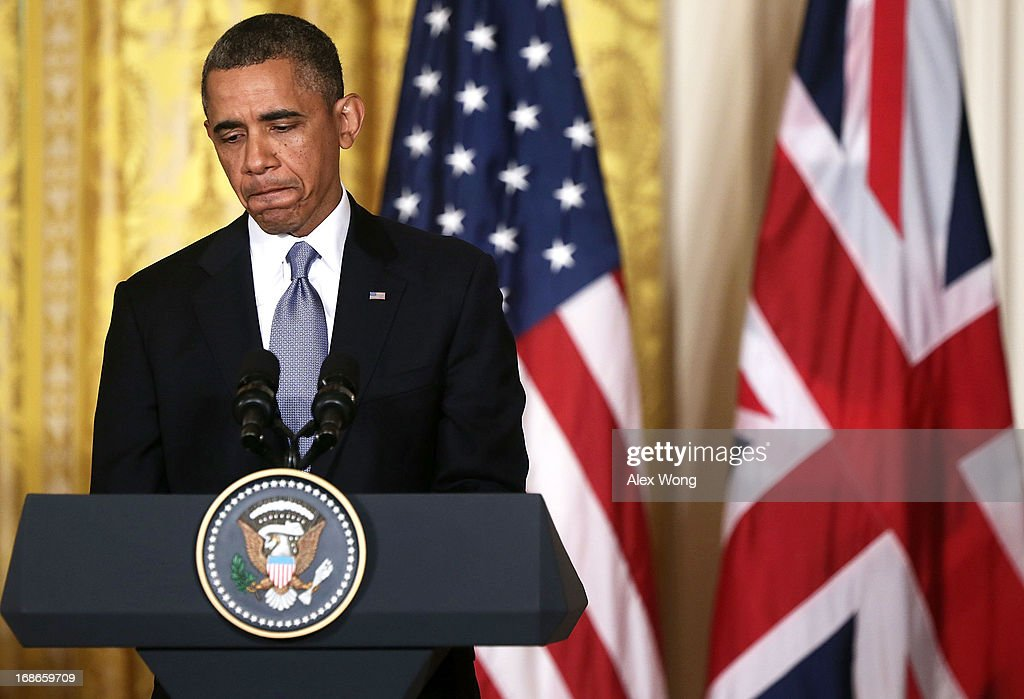 U.S. President <a gi-track='captionPersonalityLinkClicked' href=/galleries/search?phrase=Barack+Obama&family=editorial&specificpeople=203260 ng-click='$event.stopPropagation()'>Barack Obama</a> pauses during a joint news conference with British Prime Minister David Cameron in the East Room of the White House May 13, 2013 in Washington, DC. The two leaders discussed the prospect of an European Union-United States trade deal and the ongoing civil war in Syria. During his three-day visit to the United States, Cameron will also be briefed by the FBI about the Boston Marathon bombings and will travel to New York to take part in United Nations talks on new development goals.
