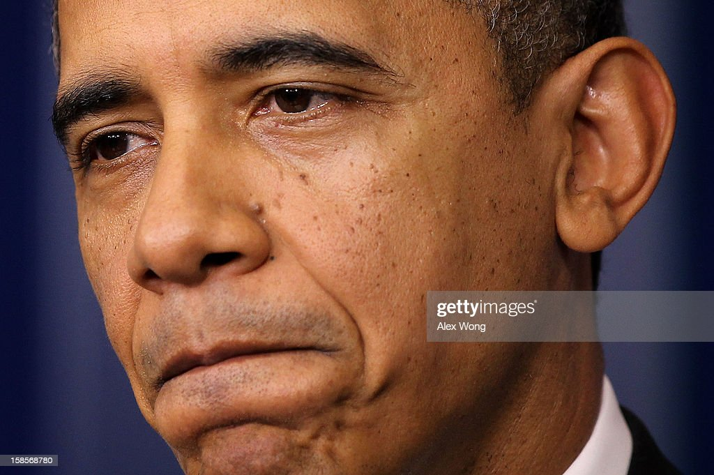U.S. President <a gi-track='captionPersonalityLinkClicked' href=/galleries/search?phrase=Barack+Obama&family=editorial&specificpeople=203260 ng-click='$event.stopPropagation()'>Barack Obama</a> pauses during an announcement on gun reform in the Brady Press Briefing Room of the White House December 19, 2012 in Washington, DC. President Obama announced that he is making an administration-wide effort to solve gun violence and has tapped Vice President Joseph Biden to lead the effort in the wake of the Sandy Hook Elementary School shooting in Newtown, Connecticut.