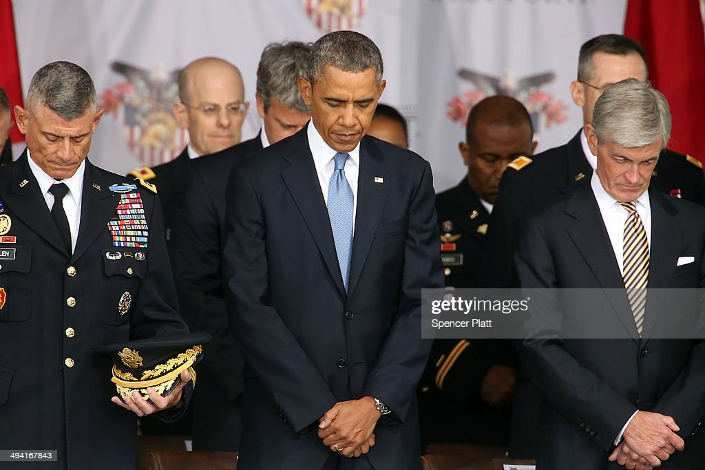 U.S. President <a gi-track='captionPersonalityLinkClicked' href=/galleries/search?phrase=Barack+Obama&family=editorial&specificpeople=203260 ng-click='$event.stopPropagation()'>Barack Obama</a> pauses for the invocation before giving the commencement address at the graduation ceremony at the U.S. Military Academy at West Point on May 28, 2014 in West Point, New York. In a highly anticipated speech on foreign policy, the President provided details on his plans for winding down America's military commitment in Afghanistan. Over 1,000 cadets are expected to graduate from the class of 2014 and will be commissioned as second lieutenants in the U.S. Army.