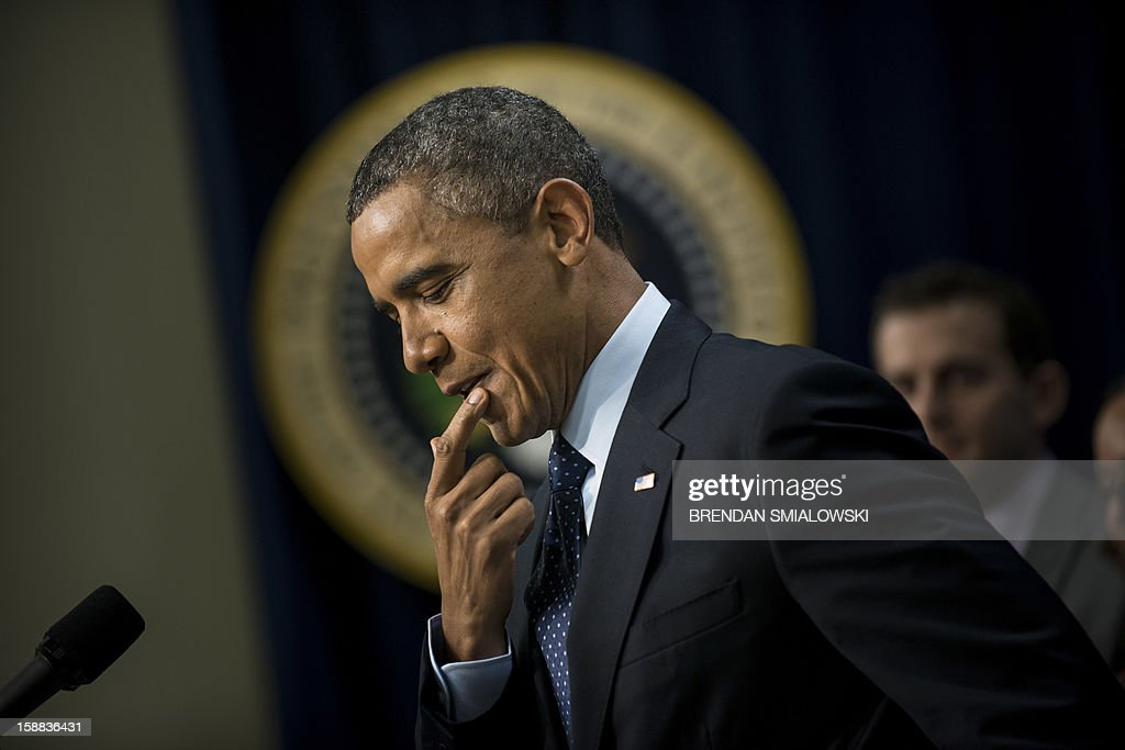 US President Barack Obama pauses while making a statement about fiscal cliff negotiations from the White House December 31, 2012 in Washington, DC. Obama said the fallback deal being negotiated in Congress ahead of a January 1 deadline would start to solve America's budget and deficit problems in several steps rather than in a big, comprehensive deal that he had hoped for. AFP PHOTO/Brendan SMIALOWSKI