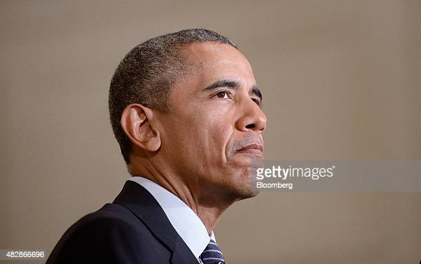 US President Barack Obama pauses while speaking about the Clean Power Plan during an event in the East Room of the White House in Washington DC US on...