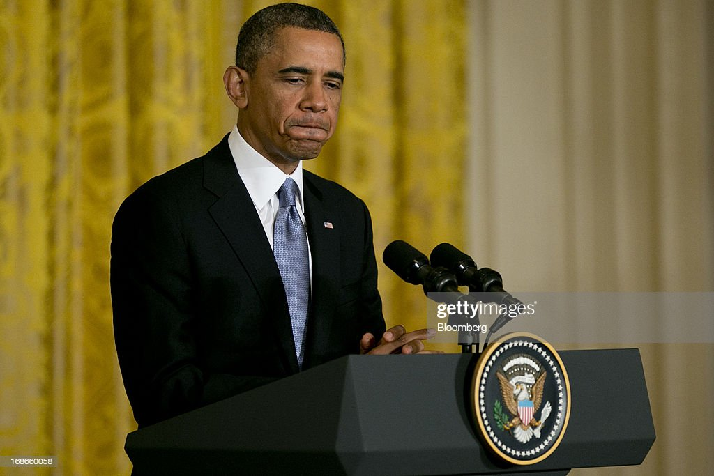 U.S. President <a gi-track='captionPersonalityLinkClicked' href=/galleries/search?phrase=Barack+Obama&family=editorial&specificpeople=203260 ng-click='$event.stopPropagation()'>Barack Obama</a> pauses while speaking during a news conference with David Cameron, U.K. prime minister, not pictured, in the East Room of the White House in Washington, D.C., U.S., on Monday, May 13, 2013. President <a gi-track='captionPersonalityLinkClicked' href=/galleries/search?phrase=Barack+Obama&family=editorial&specificpeople=203260 ng-click='$event.stopPropagation()'>Barack Obama</a> said his administration made no attempt to cover up or downplay the involvement of terrorists in last year's deadly attack on a U.S. outpost in Benghazi, Libya, and said the congressional investigation has turned into a 'political circus.' Photographer: Andrew Harrer/Bloomberg via Getty Images