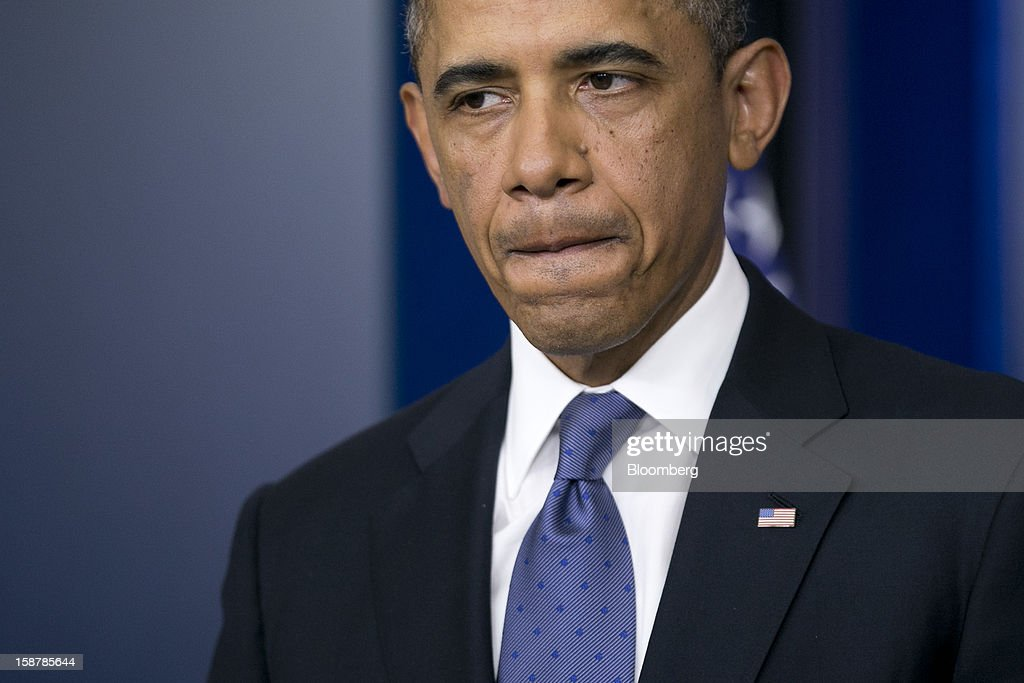 U.S. President Barack Obama pauses while speaking in the Brady Press Briefing Room at the White House in Washington, D.C., U.S., on Friday, Dec. 28, 2012. Obama is seeking an up-or-down vote on his proposal to extend tax cuts for annual income up to $250,000, absent a counteroffer from congressional leaders, an official familiar with today's budget talks said. Photographer: Andrew Harrer/Bloomberg via Getty Images