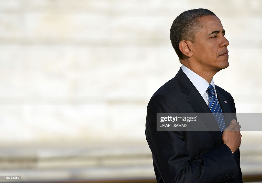 US President Barack Obama pays his respects after laying a wreath at the Tomb of the Unknowns at Arlington National Cemetery in Arlington, Virginia, on January 20, 2013. Obama and Biden will be officially sworn in for a second term in office later in the day. AFP PHOTO/Jewel Samad