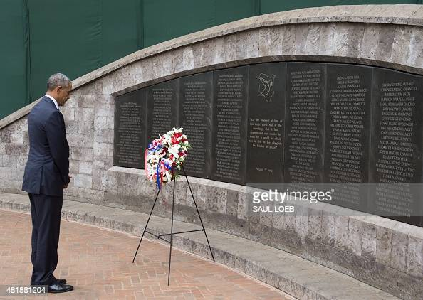 US President Barack Obama pays his respects after laying a wreath at the Memorial Park in Nairobi on July 25 commemorating the August 7 1998 bombing...