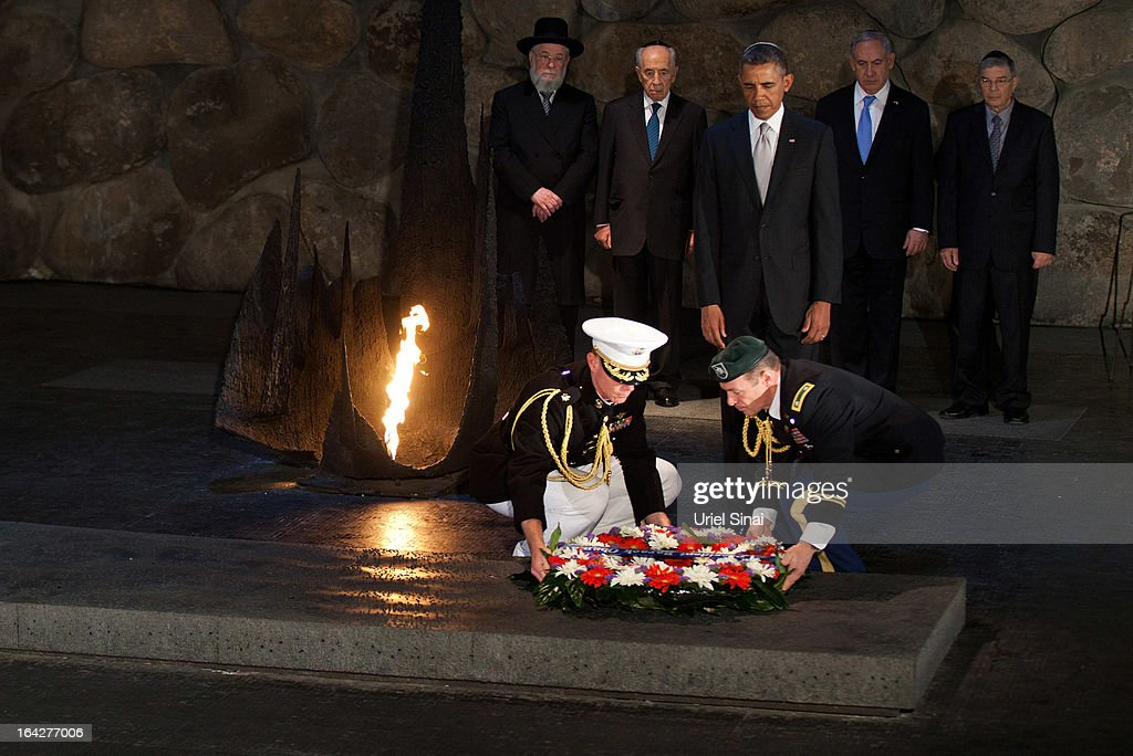 U.S. President Barack Obama pays his respects in the Hall of Remembrance in front of Israel's President Shimon Peres, Israel's Prime Minster Benjamin Netanyahu, Chairman of the Yad Vashem Directorate Avner Shalev and Rabbi Yisrael Meir Lau as marines lay a wreath on his behalf during his visit to the Yad Vashem on March 22, 2013 in Jerusalem, Israel. This is Obama's first visit as president to the region and his itinerary includes meetings with the Palestinian and Israeli leaders as well as a visit to the Church of the Nativity in Bethlehem.