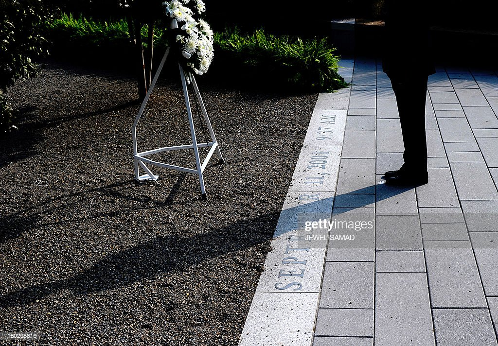 US President <a gi-track='captionPersonalityLinkClicked' href=/galleries/search?phrase=Barack+Obama&family=editorial&specificpeople=203260 ng-click='$event.stopPropagation()'>Barack Obama</a> places a wreath at the Pentagon 9/11 Memorial park to mark the 12th anniversary of the 9/11 attacks at the Pentagon in Washington, DC, on September 11, 2013. AFP PHOTO / Jewel Samad