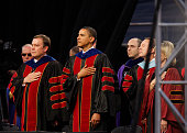 President Barack Obama places his hand over his heart with Arizona State University President Michael Crow during the National Anthem before...