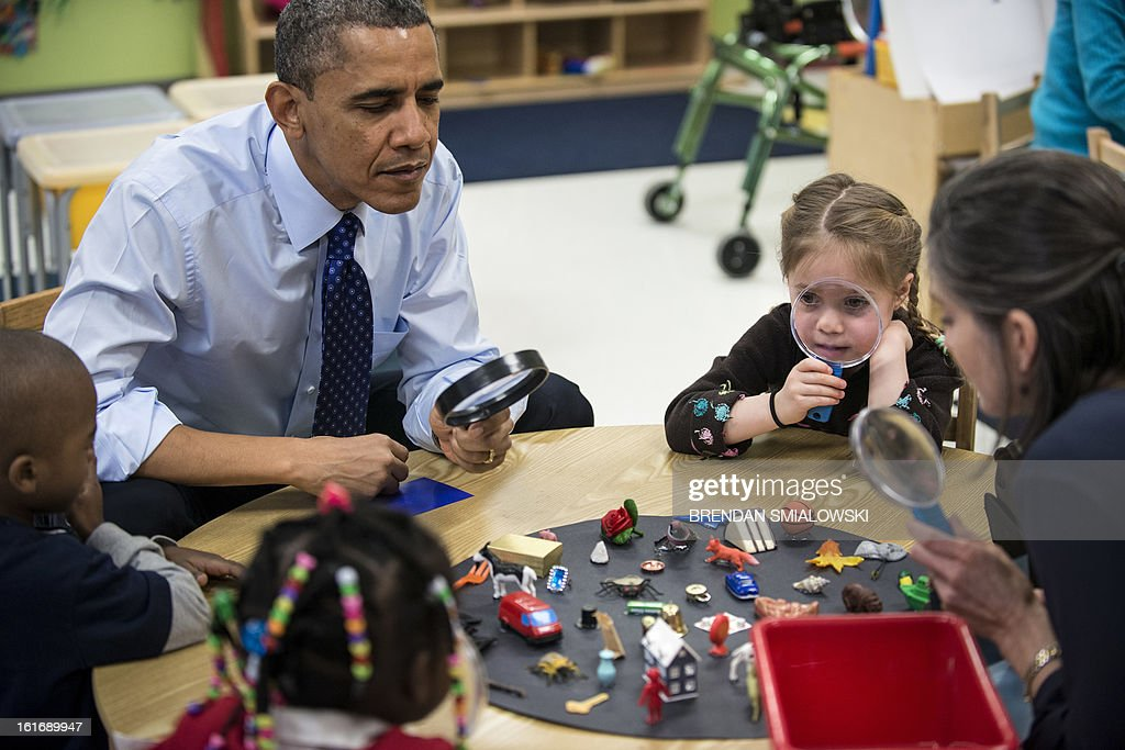 US President Barack Obama plays a learning game while visiting children at College Heights Early Childhood Learning Center February 14, 2013 in Decatur, Georgia. Obama is in Georgia to promote economic and educational initiatives he spoke about in this week's State of the Union. AFP PHOTO/Brendan SMIALOWSKI