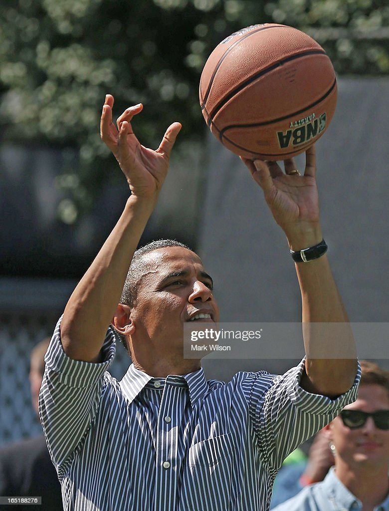 U.S. President <a gi-track='captionPersonalityLinkClicked' href=/galleries/search?phrase=Barack+Obama&family=editorial&specificpeople=203260 ng-click='$event.stopPropagation()'>Barack Obama</a> plays basketball during the annual Easter Egg Roll on the White House tennis court April 1, 2013 in Washington, DC. Thousands of people are expected to attend the 134-year-old tradition of rolling colored eggs down the White House lawn that was started by President Rutherford B. Hayes in 1878.
