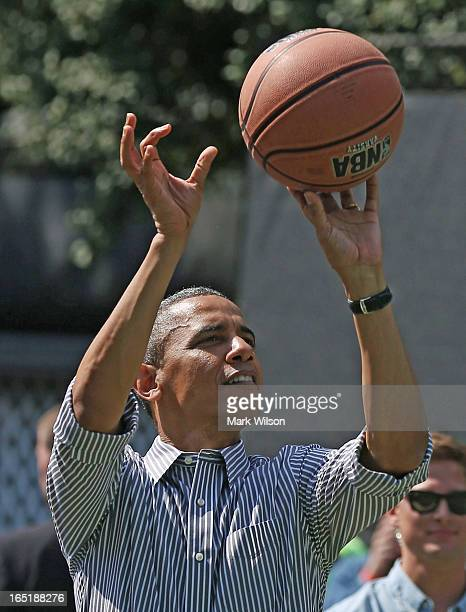 S President Barack Obama plays basketball during the annual Easter Egg Roll on the White House tennis court April 1 2013 in Washington DC Thousands...