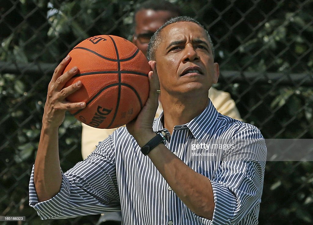 U.S. President Barack Obama plays basketball during the annual Easter Egg Roll on the White House tennis court April 1, 2013 in Washington, DC. Thousands of people are expected to attend the 134-year-old tradition of rolling colored eggs down the White House lawn that was started by President Rutherford B. Hayes in 1878.