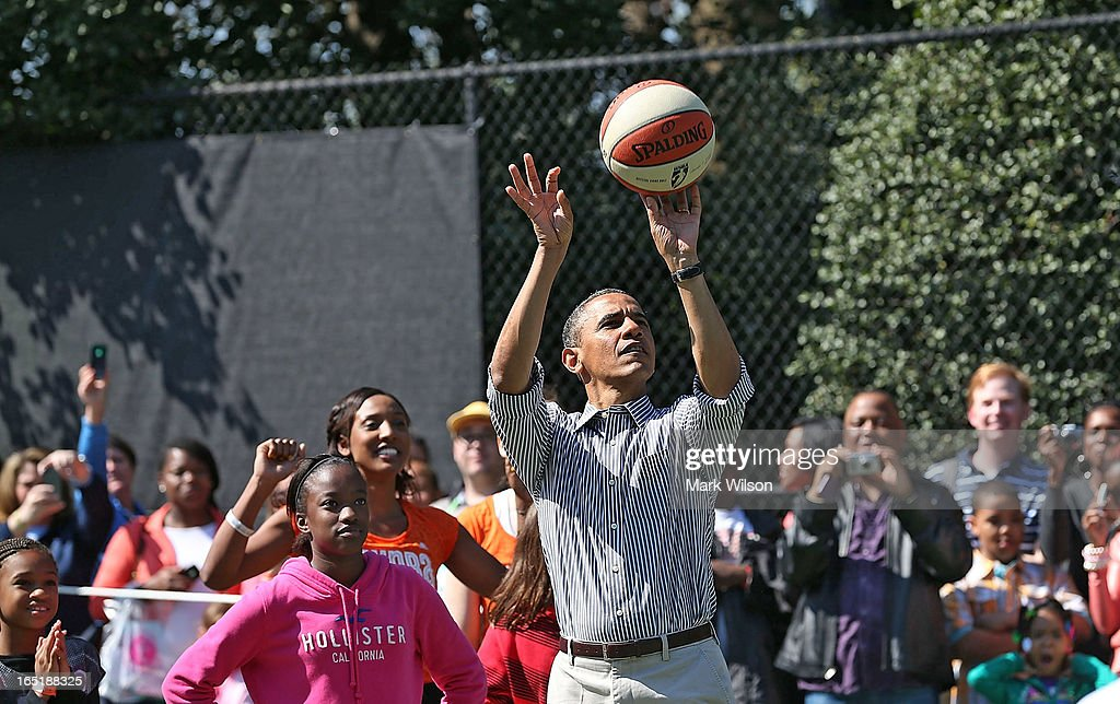 U.S. President Barack Obama plays basketball with children during the annual Easter Egg Roll on the White House tennis court April 1, 2013 in Washington, DC. Thousands of people are expected to attend the 134-year-old tradition of rolling colored eggs down the White House lawn that was started by President Rutherford B. Hayes in 1878.