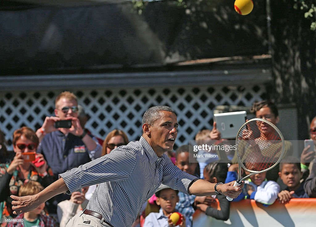 U.S. President Barack Obama plays tennis with young children during the annual Easter Egg Roll on the White House tennis court April 1, 2013 in Washington, DC. Thousands of people are expected to attend the 134-year-old tradition of rolling colored eggs down the White House lawn that was started by President Rutherford B. Hayes in 1878.