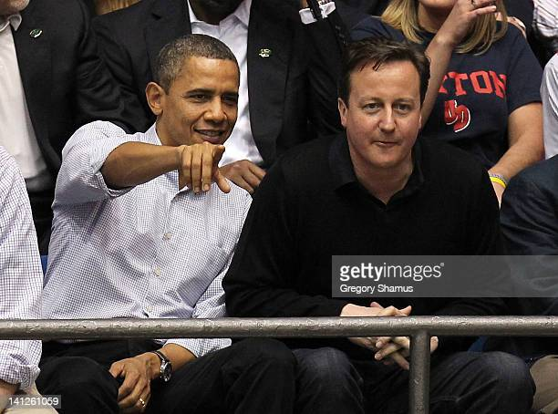 S President Barack Obama points as he talks with British Prime Minister David Cameron at UD Arena as the Western Kentucky Hilltoppers take on the...