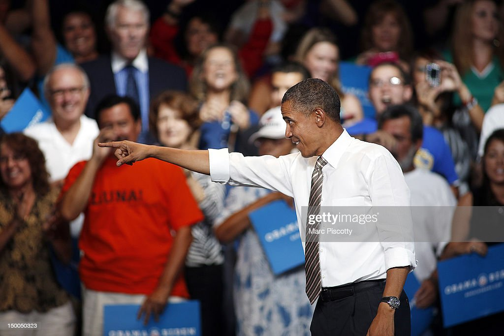 U.S. President <a gi-track='captionPersonalityLinkClicked' href=/galleries/search?phrase=Barack+Obama&family=editorial&specificpeople=203260 ng-click='$event.stopPropagation()'>Barack Obama</a> points to a member of the crowd after speaking at a campaign stop at the Palace of Agriculture on the Colorado State Fairgrounds August 9, 2012 in Pueblo, Colorado. Obama covered a number of topics including paying down our debt in a balanced way, job growth and creation and preventing a scheduled tax increase on 98.