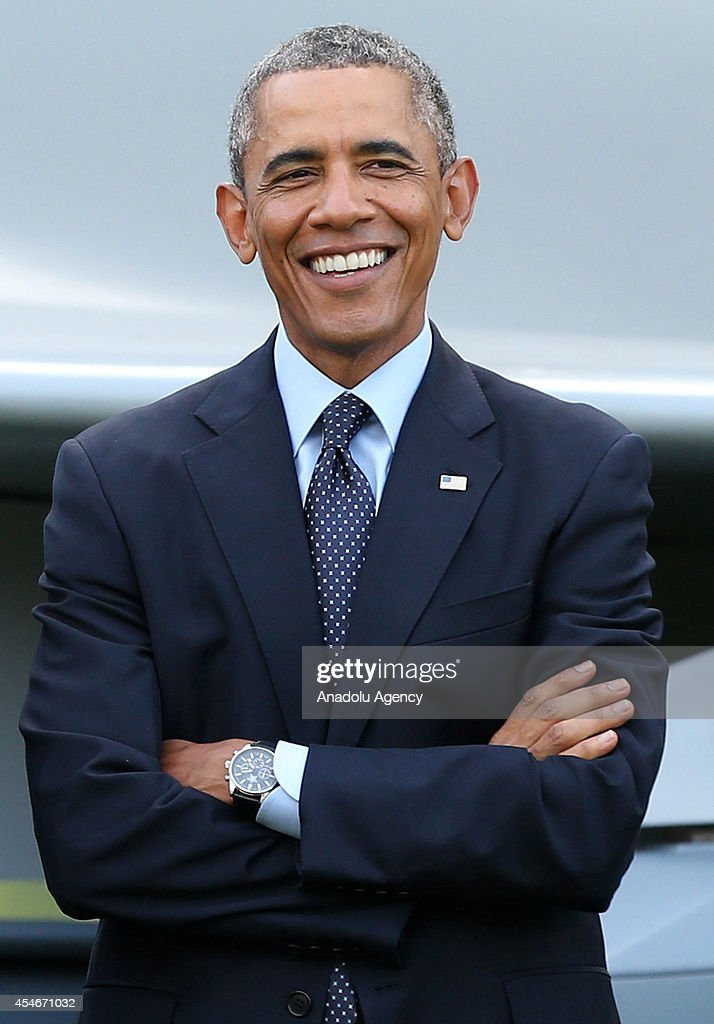 President Barack Obama poses before watching a flypast of military aircraft on the second day of the NATO 2014 Summit at the Celtic Manor Resort in...