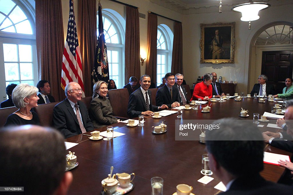 U.S. President <a gi-track='captionPersonalityLinkClicked' href=/galleries/search?phrase=Barack+Obama&family=editorial&specificpeople=203260 ng-click='$event.stopPropagation()'>Barack Obama</a> (4L) poses for a brief still photo session during a cabinet meeting on December 8, 2010 in Washington, DC. Obama has been on the defensive since he compromised on his tax cut policy with Congressional Republicans.