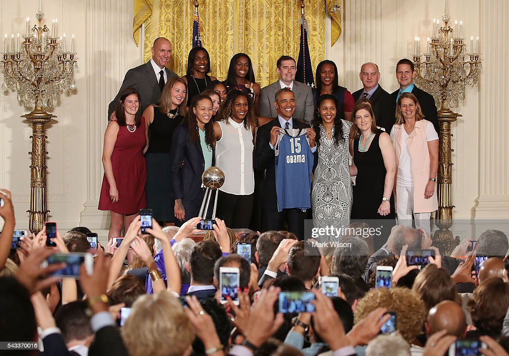 US President Barack Obama poses for a picture with the Minnesota Lynx, during an event to honor the 2015 WNBA champions, in the East Room at the White House June 27, 2016 in Washington, DC.